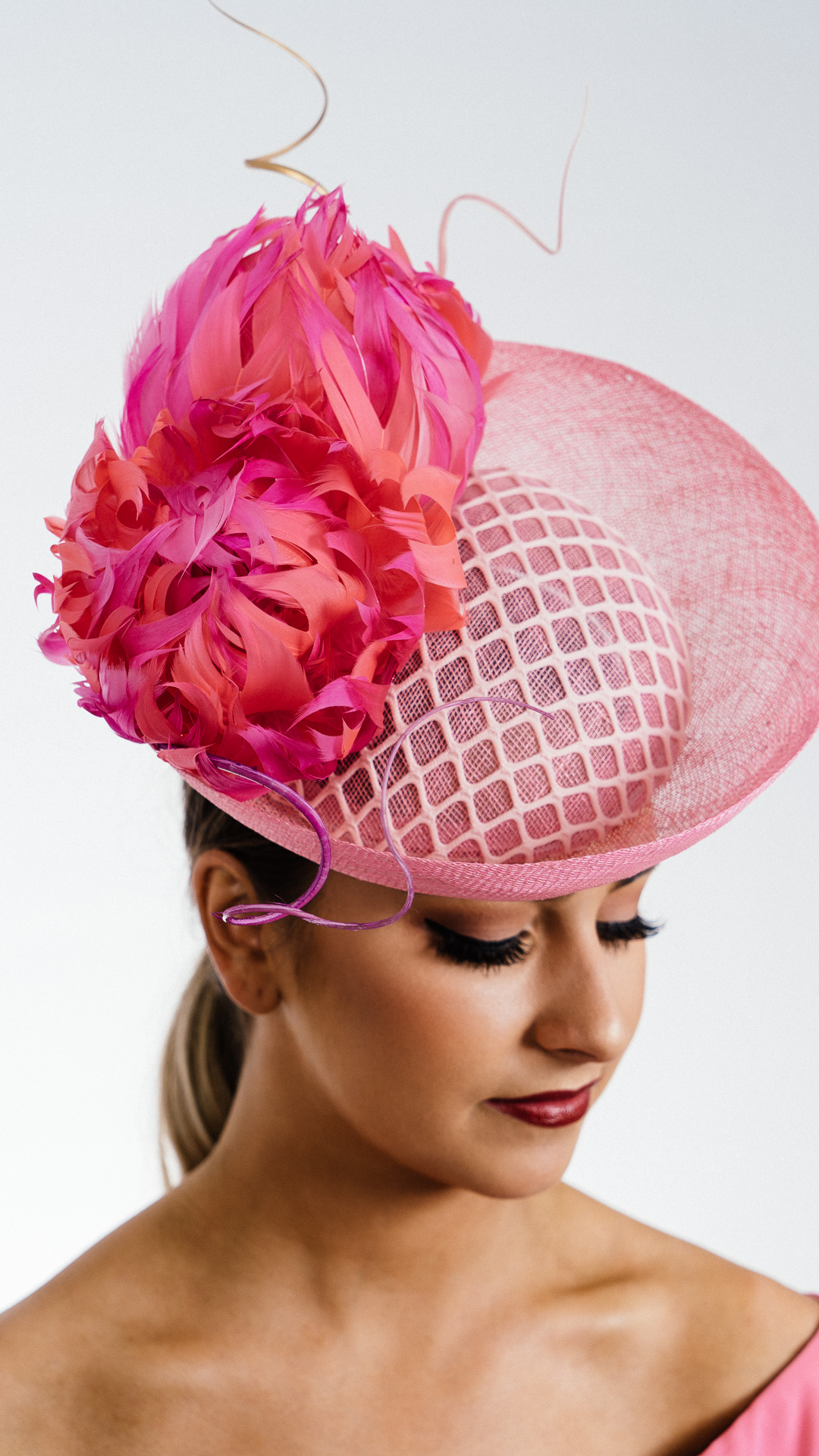 Pink brim upsweep feather flowers