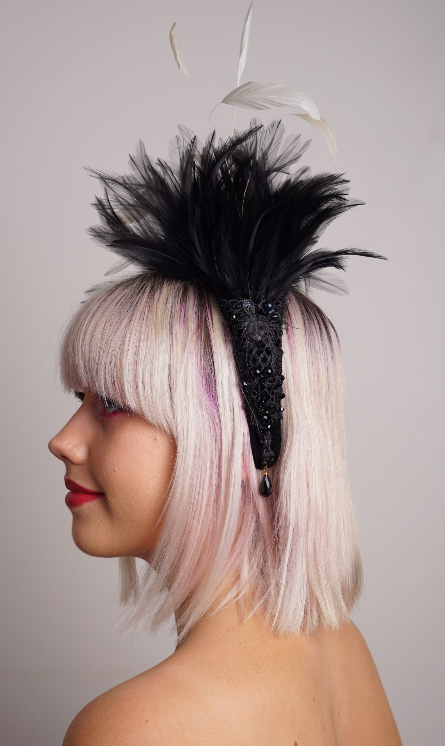 black feather crown side view
